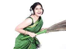 Housemaid listening to music Stock Photography