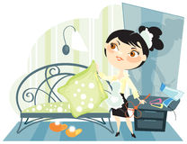 Housemaid shakes up pillows in a bedroom Royalty Free Stock Image