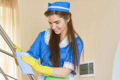 Housemaid at work smiling. Maid cleaning the house Stock Photo