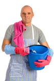 Houseman. Is cleaning the house with apron and tools Stock Photo