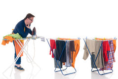 Houseman doing the laundry. Houseman doing ironing, clothesline with washed clothing, daily household Stock Photography