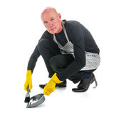Houseman with dustpan and brush Royalty Free Stock Image