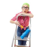 Housepainter. Surprised woman with paint roller on ladder. Girl ready for renovating or wall painting ,isolated on white Stock Image