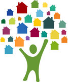Houses. Abstract man with many colorful house icons Royalty Free Stock Photo