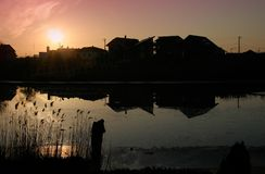 Houses. By the lake at sunset Royalty Free Stock Images