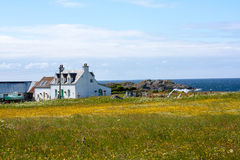 Houses abd fields of Iona in the Inner Hebrides, Scotland. Iona is a small island in the Inner Hebrides off the Ross of Mull on the western coast of Scotland. It royalty free stock photos