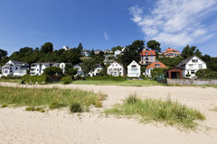 Houses above the Elbe River beach Stock Photos