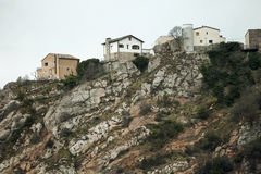 Houses above top of peak of a mountain Royalty Free Stock Photo