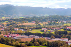 Houses Ainhoa fields. In France with the mountains are in the background  on a cloudy day Stock Photos
