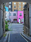 Houses in an alley. Old houses in an alley in London stock images