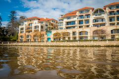 Houses along a canal. Apartments line the banks of a canal in East Perth Royalty Free Stock Photo
