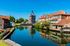 Houses along canal in Enkhuizen Netherlands. Houses along canal in City Center of Enkhuizen Netherlands Stock Photo