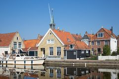 Houses along a canal in Makkum, an old Dutch village stock image