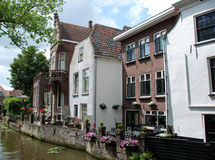 Houses along a canal in The Netherlands. Royalty Free Stock Photo