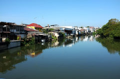 Houses along canal in Thailand Stock Photos