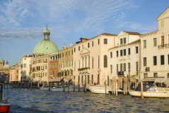 Houses along canale grande at sunset Stock Images