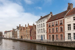 Houses along the canals of Brugge, Belgium. Tourism destination in Europe Royalty Free Stock Images
