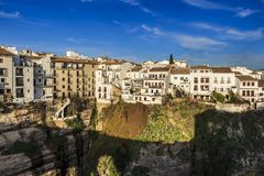 Houses along the El Tajo gorge over south side of Ronda. Houses along the El Tajo gorge over at La Ciudad, south side of Ronda stock photos