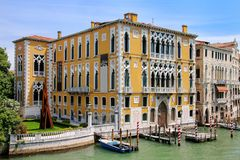Houses along Grand Canal in Venice, Italy. Venice is situated across a group of 117 small islands that are separated by canals and linked by bridges royalty free stock photos
