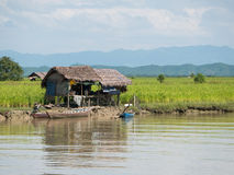 Houses along the Kaladan River in Myanmar Stock Photography