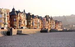 Houses along pebble beach Royalty Free Stock Image