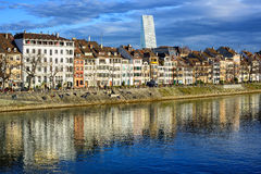 Houses along the Rhine river with Roche Tower in background, Basel, Switzerland stock photos