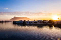 Houses along River at sunset with Table Mountain Royalty Free Stock Photos