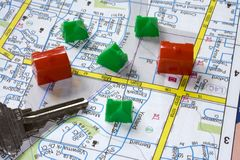 Houses along the Road. Toy buildings on a main street on a road map stock photography