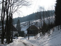 Houses along the road in winter with snow Stock Photo