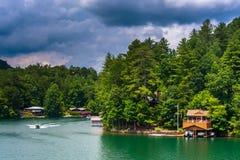 Houses along the shore of Lake Burton, in Georgia. Royalty Free Stock Photo