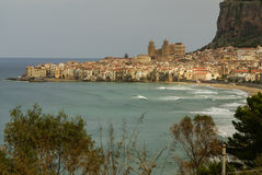 Houses along the shoreline and cathedral in background, Cefalu, Stock Image