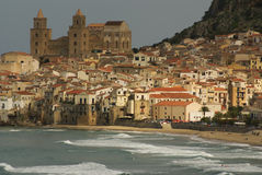 Houses along the shoreline and cathedral in background, Cefalu,. Sicily Royalty Free Stock Photo