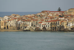 Houses along the shoreline and cathedral in background, Cefalu, Royalty Free Stock Photos