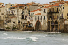 Houses along the shoreline and cathedral in background, Cefalu, Royalty Free Stock Image