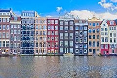 Houses in Amsterdam. Narrow old housing buildings in Amsterdam, Netherlands with reflection in a water canal stock photography