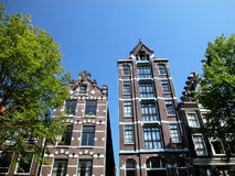 Houses in Amsterdam, Netherlands. Ancient houses in Amsterdam, view from the canal, Netherlands Stock Photo