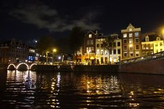 Houses in Amsterdam seen from water at night. Houses in Amsterdam seen from water by night Stock Photos