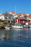 Houses And Boats At The Jetty Royalty Free Stock Images