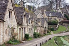 Houses of Arlington Row in the Cotswold village of Bibury, Engla. Houses of Arlington Row in the Cotswold village of Bibury, Gloucestershire, England Stock Images