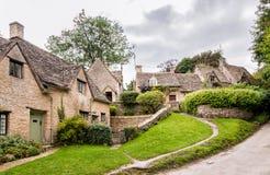 Houses of Arlington Row in the village of Bibury. England Royalty Free Stock Photo