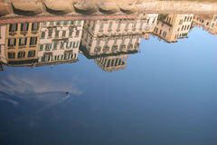 Houses on Arno river, Florence. Ancient houses reflecting into the water on Arno river, Florence, Italy Royalty Free Stock Photography