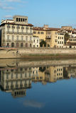 Houses on Arno river, Florence, Italy. Ancient houses reflecting into the water on Arno river, Florence, Italy Royalty Free Stock Images