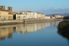 Houses on Arno river, Florence, Italy. Ancient houses reflecting into the water on Arno river, Florence, Italy Royalty Free Stock Photo