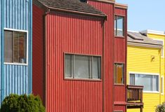 Houses, attached. Red, yellow and blue houses, attached Stock Images