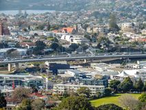Houses in Auckland City, Auckland, New Zealand. Numerous houses and cars on a bridge during daylight hours Stock Images