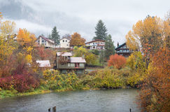 Houses in Autumn front water park, Leavenworth Stock Photo