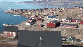 Houses on background of icebergs, snow and ice in the Arctic Ocean. Iceland- 8 September 2016: Houses on background of icebergs, snow and ice in the Arctic stock video footage