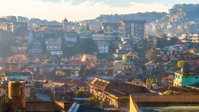 Houses in Baguio city, Philippines. Sunrise lightrays hitting the walls of hilltop houses Stock Photography