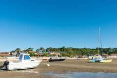 Arcachon Bay, France, boats at low tide. Houses on the beach and boats at low tide near the Cap Ferret on the Arcachon Bay Stock Photo