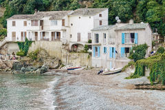 Houses by the beach in Corsica Stock Photo